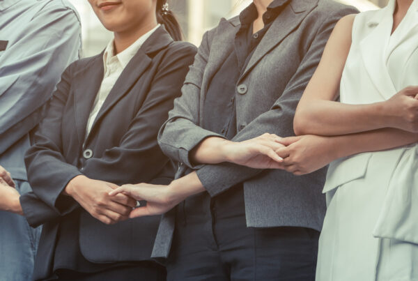 Business people holding hands